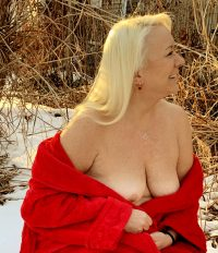 white woman blonde hair bare breast with red robe off the shoulders