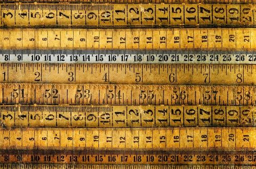different colored rulers with measure visible lined in a row from top to bottom