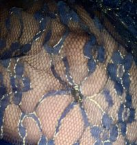 blue lace over woman's breast nipple visible under the lace