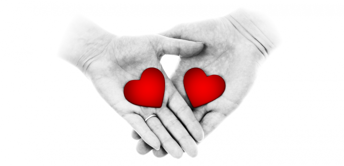 good people white background two hands one male and one female with red hearts on the palms facing the camera